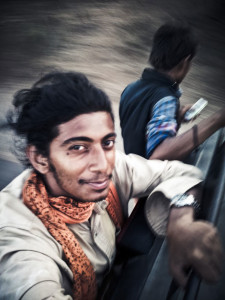 Selfie At Warp Speed. Hanging on the back of a rickshaw somewhere near Girnar in Gujarat.