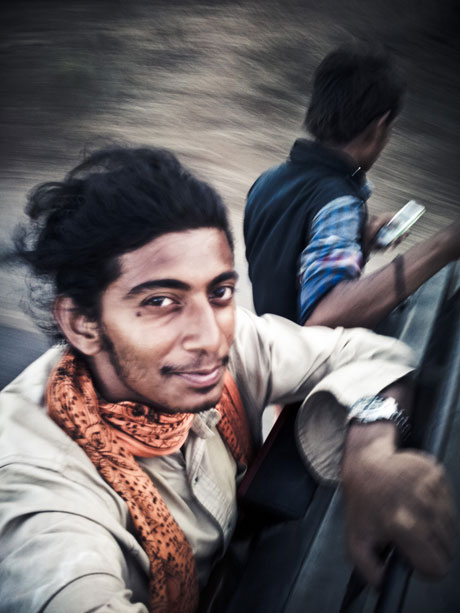 Selfie At Warp Speed. Hanging on the back of a rickshaw somewhere near Sasan in Gujarat.